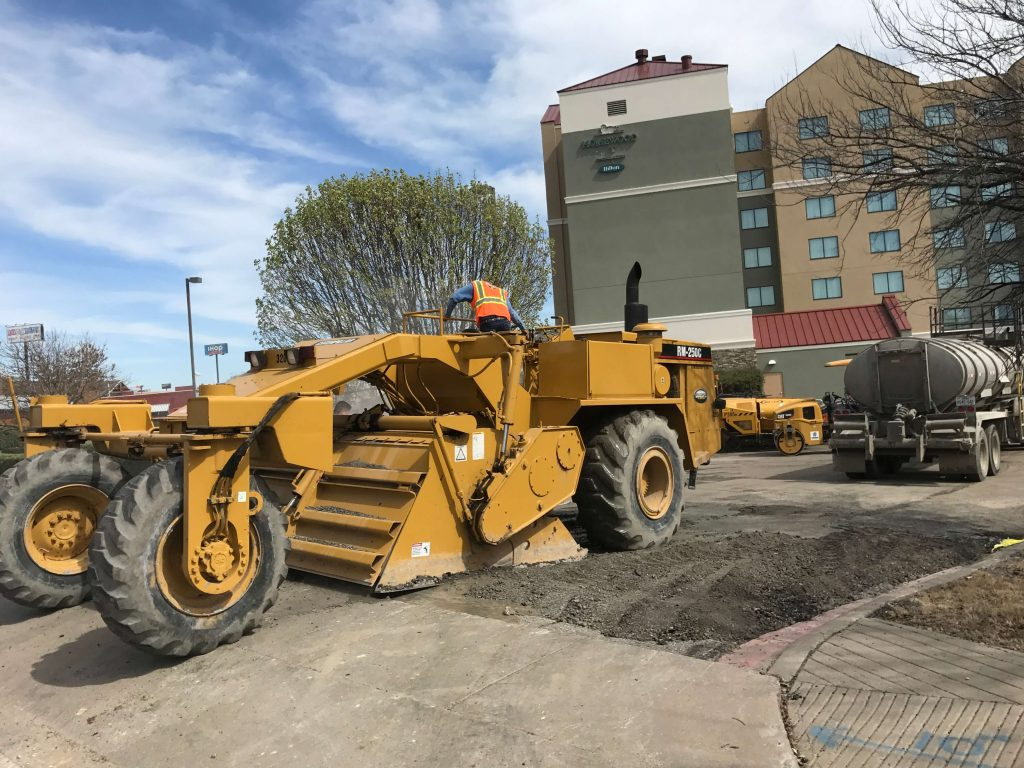 Pulverizing and Stabilizing failed areas in a Fort Worth Homewood Suites before asphalt overlay
