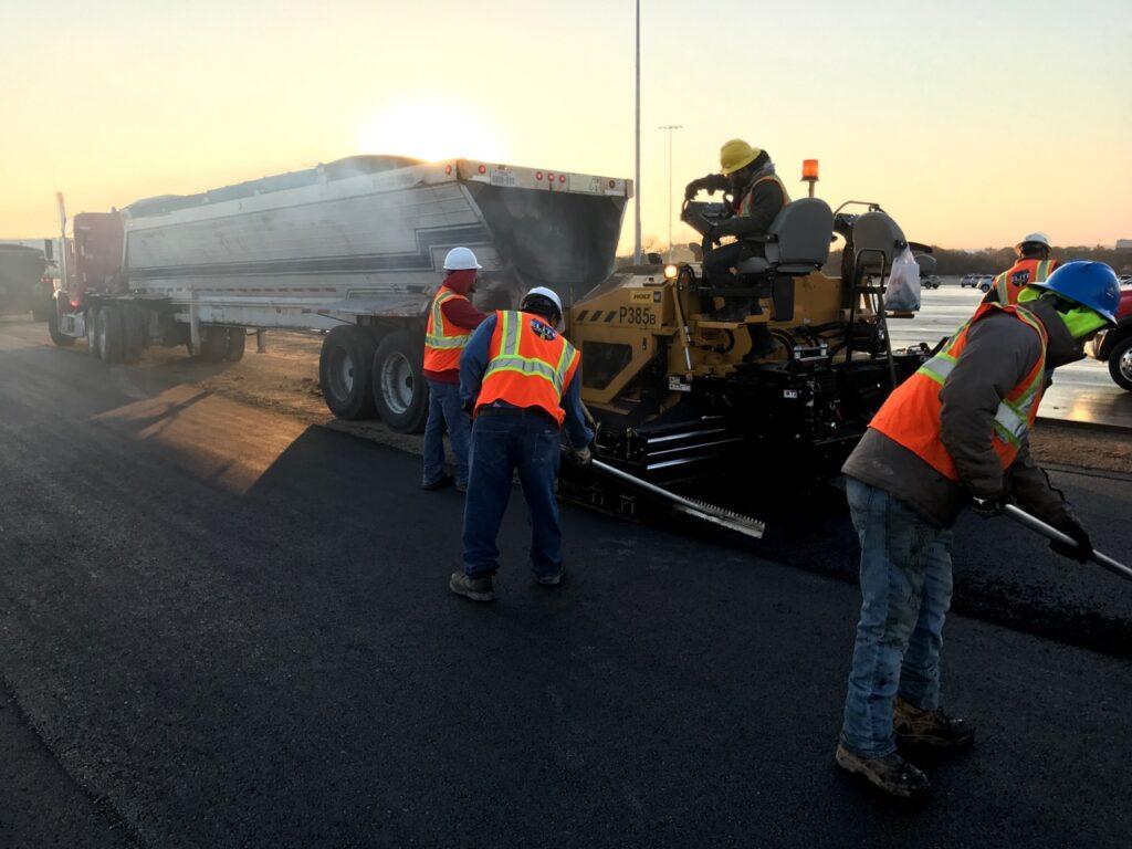 Elite Asphalt team paving in the Forth Worth, Texas