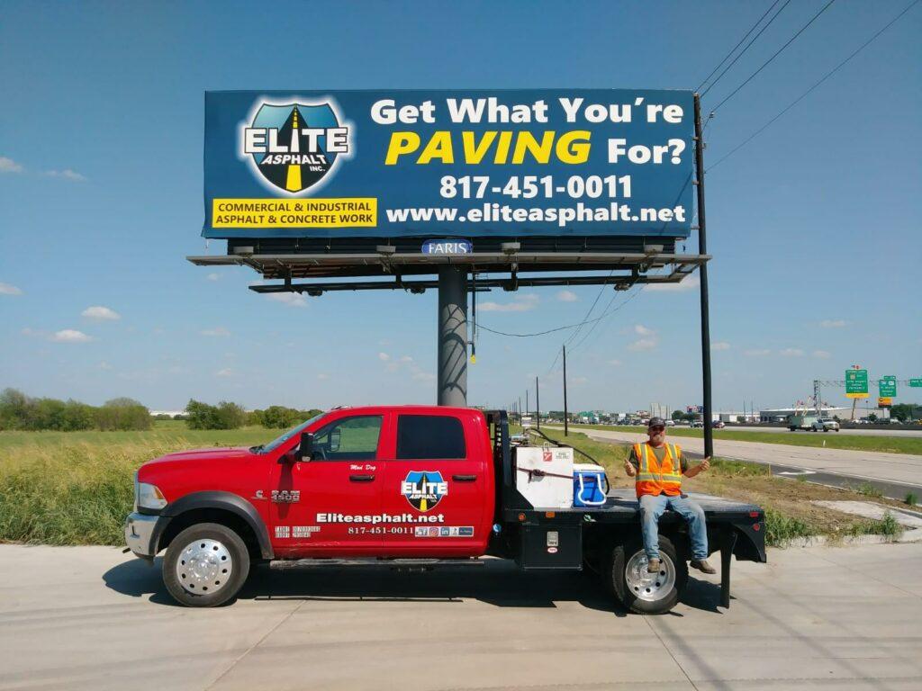 "alt text to: Elite Asphalt billboard for asphalt paving company in Texas, ""Get what you're paving for"""